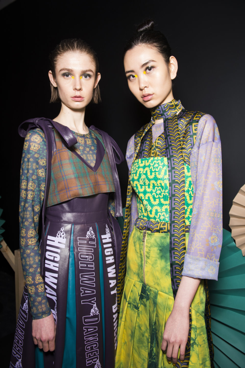 Katie Ann McGuigan AW19 runway picture of two models wearing vibrant prints.